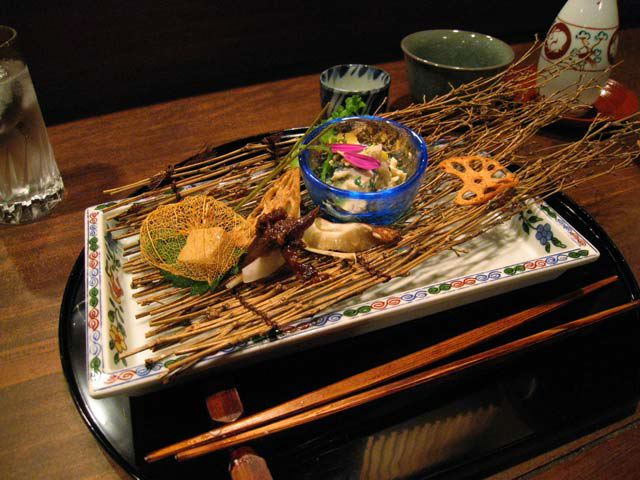Kaiseki dish on a mat of sticks