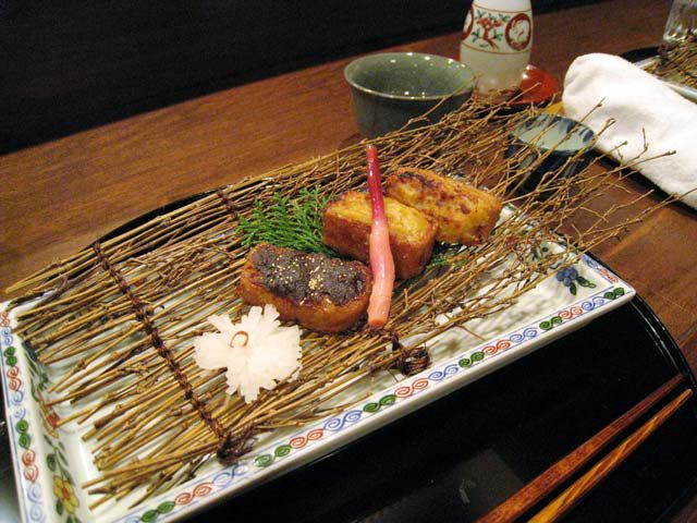 Another dish served on a bed of twigs